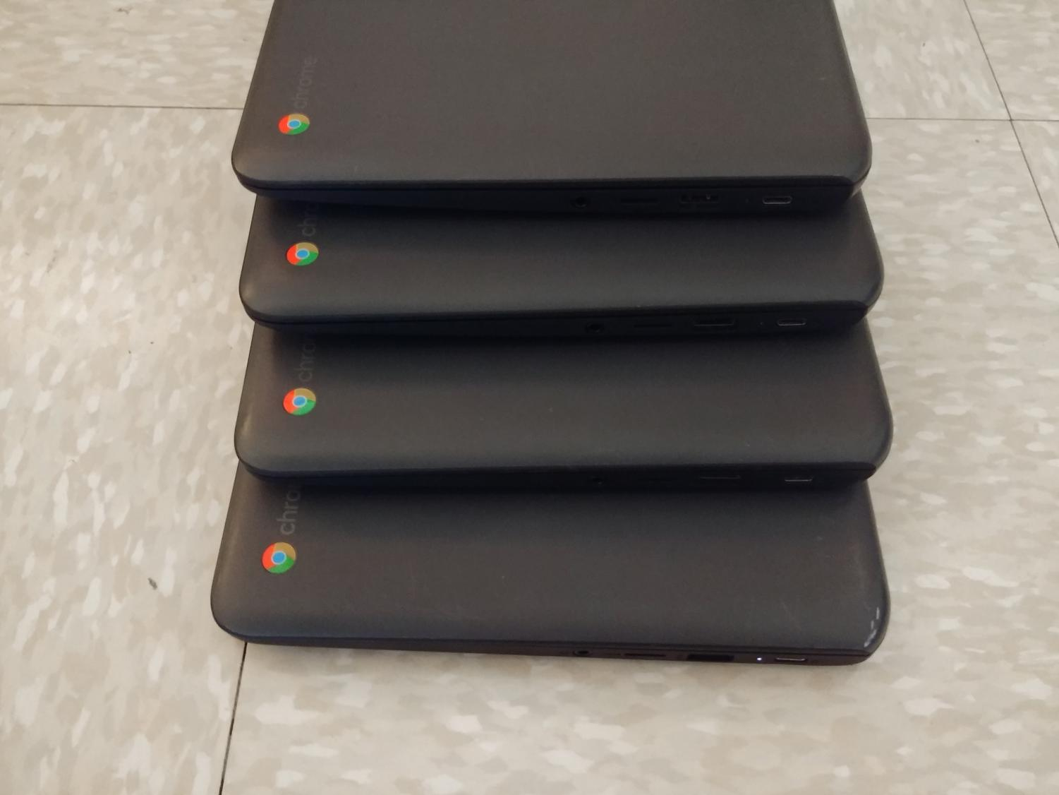 A quatrain of DHS Chromebooks.