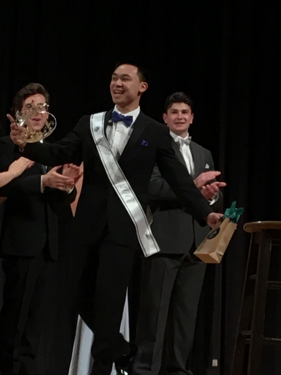 Senior Anthony Lee accepts the crown as the 2017 Mr. Dartmouth.