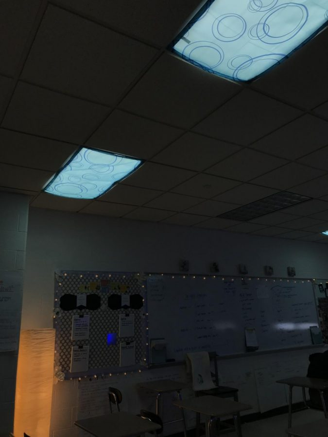 Blue light covers help to subdue the glare of fluorescent lights in some classrooms.