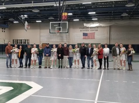 Seniors on the girls varsity basketball team being recognized at Senior Night, before cancellations rained down.